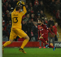 Football - 2019 / 2020 UEFA Champions League - Round of Sixteen, Second Leg: Liverpool (0) vs. Atletico Madrid (1)<br /> <br /> Atletico Madrid goalkeeper Jan Oblak saves a shot from Liverpool's Mohamed Salah, at Anfield.<br /> <br /> <br /> COLORSPORT/TERRY DONNELLY