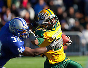 "Norfolk State's Victor Harrison (23) avoids Hampton's Delbert Tyler (34) during ""The Battle of the Bay"" won by Hampton 7 - 6 and held at Armstrong Stadium on the campus of  Hampton University in Hampton, Virginia.   (Photo by Mark W. Sutton)"