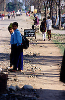 Surkhet, 28 February 2005...Civilians walk across a Royal Nepal Army area in the city of Birendranagar.
