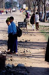 Surkhet, 28 February 2005...Civilians walk across a Royal Nepal Army area in the city of Birendranagar.