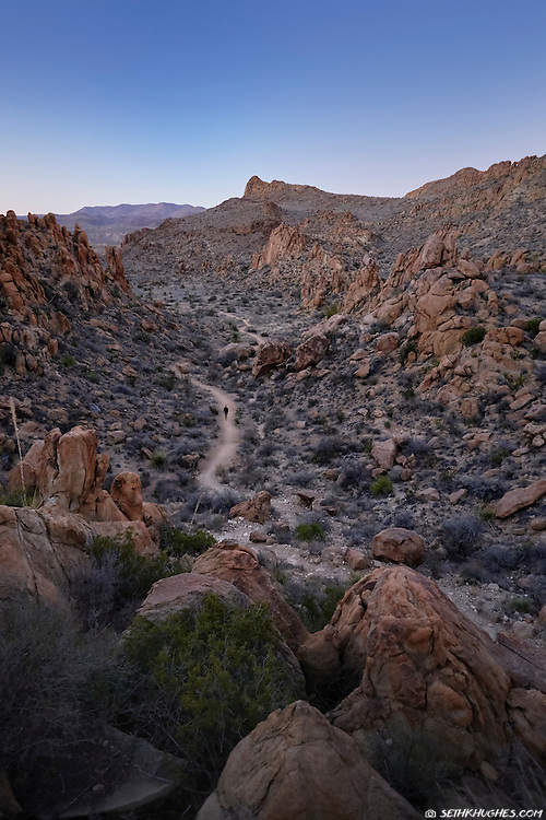 A hiker walks along the Balanced Rock Trail in Big Bend National Park, Texas.
