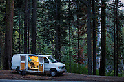 Climber Alex Honnold cooking dinner in his van somewhere along the road in California