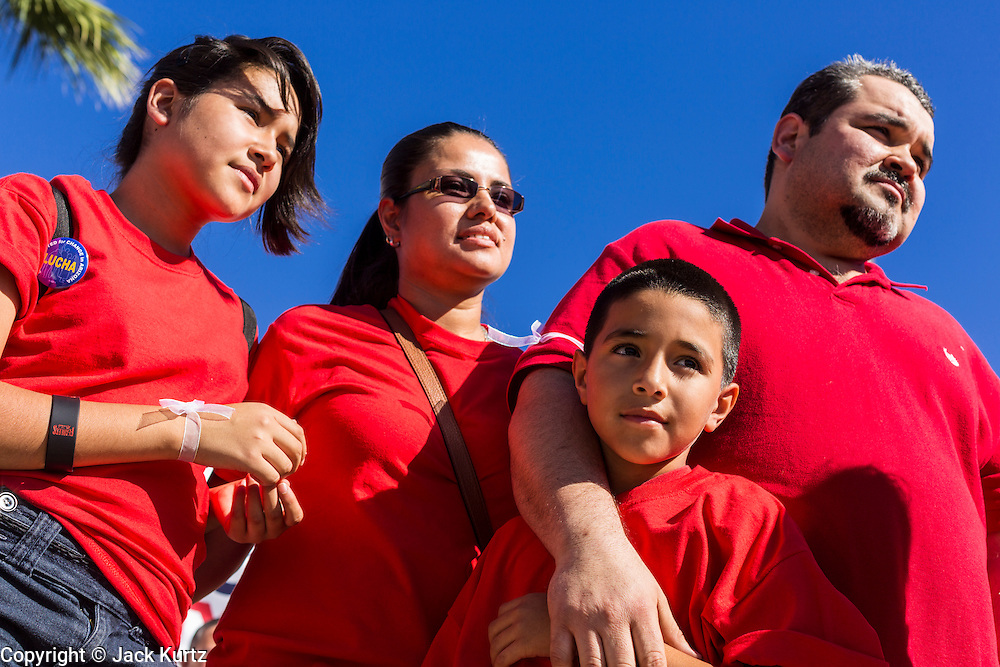 05 OCTOBER 2013 - PHOENIX, ARIZONA: A family of immigrants at an immigration reform rally in Phoenix. More than 1,000 people marched through downtown Phoenix Saturday to demonstrate for the DREAM Act and immigration reform. It was a part of the National Day of Dignity and Respect organized by the Action Network.   PHOTO BY JACK KURTZ