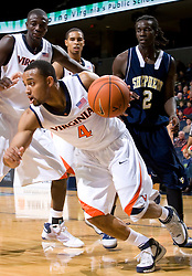 Virginia guard Calvin Baker (4) in action against Shepherd.  The Virginia Cavaliers defeated the Shepherd Rams 87-52 in an NCAA basketball exhibition game at the University of Virginia's John Paul Jones Arena in Charlottesville, VA on November 9, 2008.