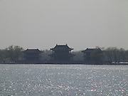 view over the lake at the Summer Palace with three pavilions in the distance Beijing