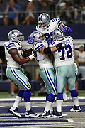 Dallas Cowboys tight end Jason Witten (82) leaps and celebrates with Dallas Cowboys tackle Tyron Smith (77), Dallas Cowboys guard Zack Martin (70), and Dallas Cowboys center Travis Frederick (72) after catching a 10 yard touchdown pass for a 10-6 second quarter Cowboys lead during the 2017 NFL week 3 preseason football game against the Oakland Raiders, Saturday, Aug. 26, 2017 in Arlington, Tex. The Cowboys won the game 24-20. (©Paul Anthony Spinelli)