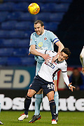 Sunderland defender John O'Shea (16) and Bolton Wanderers striker Zach Clough (40) during the EFL Sky Bet Championship match between Bolton Wanderers and Sunderland at the Macron Stadium, Bolton, England on 20 February 2018. Picture by Craig Galloway.