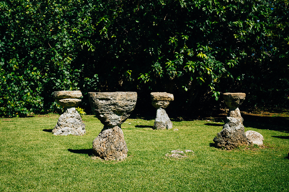 Ancient latte stones near a cultural heritage site on Guam island.
