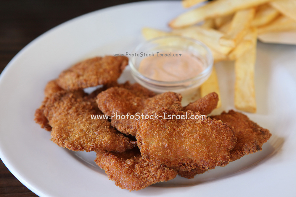 Deep fried breaded chicken nuggets with chips
