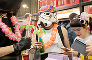 UNITED KINGDOM, London: 24 May 2019 <br /> A cosplay fan dressed as a Star Wars Supertrooper drinks a cocktail in the ExCeL Centre in London earlier today for the MCM London Comic Con. Thousands of cosplay enthusiasts will come to the ExCeL Centre across the next three days to enjoy the convention.