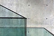 detail of a modern glass balcony shadow and concrete wall