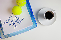 Coffee cup with tennis balls and note on surface