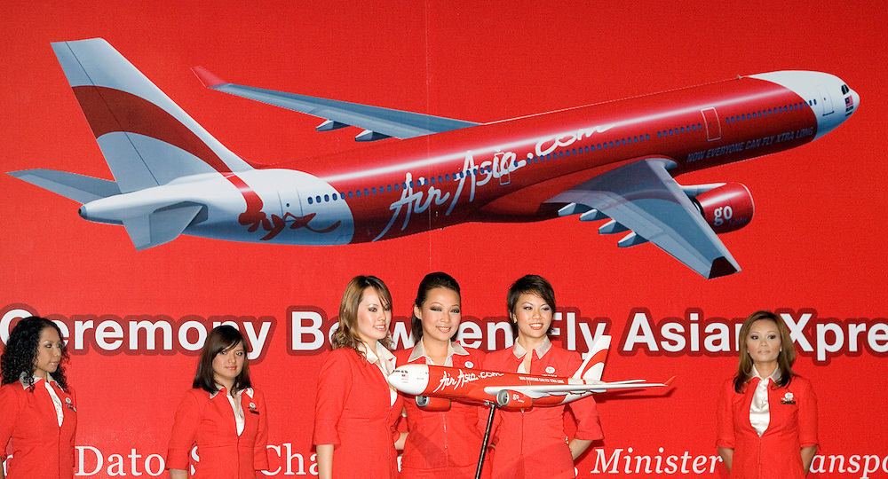Air Asia flight attendants pose during the signing ceremony between Air Asia X and Airbus in Kuala Lumpur, Malaysia on 23 April 2007.
