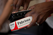 A nurse prepares to give a dose of Pabrinex to a resident at St Mungo's Homeless Hostel in Clapham Common, London.  Pabrinex is an intramuscular high potency injection given after severe Vitamins B and C deficiency commonly caused my malabsorption due to alcoholism.