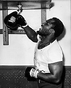 'Smokin' Joe' Frazier (born January 12, 1944 in Beaufort, South Carolina) 1968 world heavyweight boxing champion, was the first American boxer to win both the Olympic gold medal and the professional world title in the heavyweight division. Frazier is considered one of the greatest heavyweights of all time, but he is perhaps most famous for his trilogy of fights Ali, the first of which, won by Frazier in a unanimous decision, has often been called one of boxing's greatest bouts. Frazier was known for a relentless pursuit of opponents, quickly cutting off angles of escape using a chugging locomotion reminiscent of a train's advance up a hill. The contrast with Ali's dancing, non-linear style could not have been greater. Winner of Olympic 1964 Tokyo Gold medal for Boxing - Heavyweight. He had a band called 'Joe Frazier & the Knockouts' that released songs in the 'soul' genre. In the 1990s, he trained award winning artist Richard T. Slone to box. Operated a boxing gym in North Philadelphia since the late 1960s, used by fighters such as Michael Spinks, Meldrick Taylor, his son Marvis Frazier, and Bernard Hopkins. Father of 11 children..PICTURED: JOE FRAZIER.