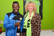 Match sponsors Viva present a bottle of champagne to Man of the match Forest Green Rovers midfielder Drissa Traore (4) during the Vanarama National League match between Forest Green Rovers and Dagenham and Redbridge at the New Lawn, Forest Green, United Kingdom on 29 October 2016. Photo by Alan Franklin.