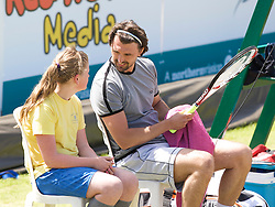 LIVERPOOL, ENGLAND - Tuesday, June 10, 2008: Goran Ivanisevic (CRO) chats with a ball girl during the opening day of the Tradition-ICAP Liverpool International Tennis Tournament at Calderstones Park. (Photo by David Rawcliffe/Propaganda)