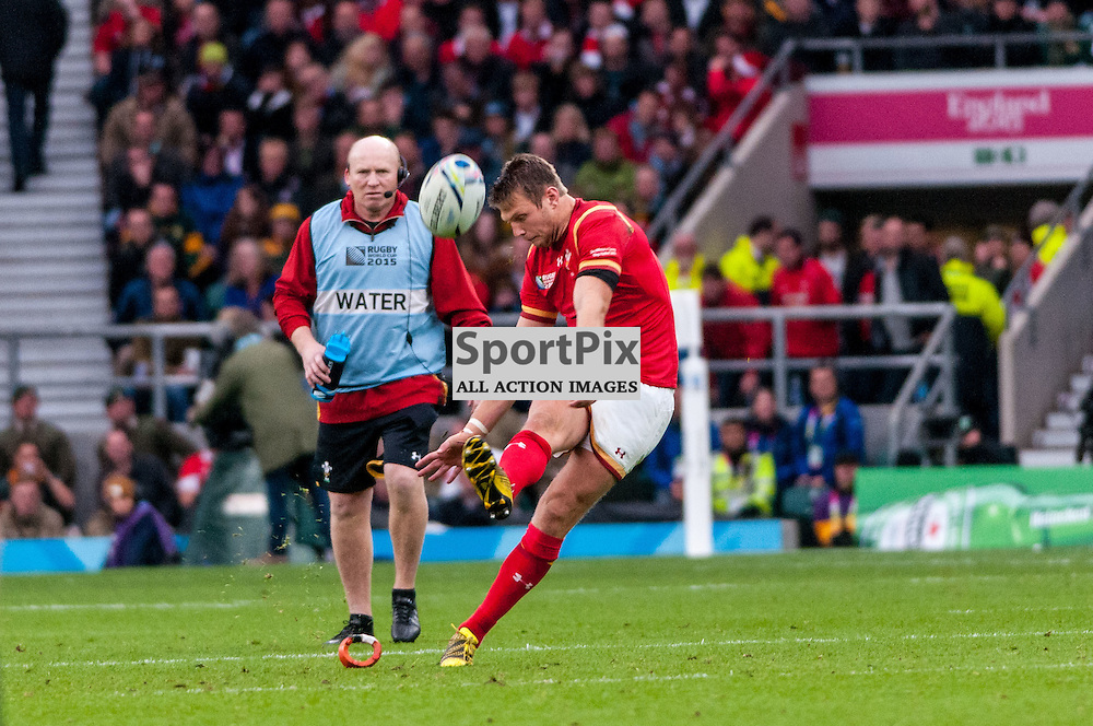 Dan Biggar of Wales kicks a penalty as Neil Jenkins watches on. Action from the South Africa v Wales quarter final game at the 2015 Rugby World Cup at Twickenham in London, 17 October 2015. (c) Paul J Roberts / Sportpix.org.uk