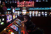 A woman gambles at a slop machine at a casino in Las Vegas.
