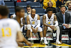Dec 20, 2017; Morgantown, WV, USA; West Virginia Mountaineers guard Jevon Carter (2) and West Virginia Mountaineers guard Daxter Miles Jr. (4) are seen watching on the bench late in the second half against the Coppin State Eagles at WVU Coliseum. Mandatory Credit: Ben Queen-USA TODAY Sports