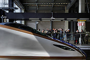 Kanazawa, March 16 2015 - Travelers photographing the new Hokuriku Kagayaki Shinkansen (bullet train) at Kanazawa train station. The shinkansen service between Tokyo and Kanazawa was introduced on 14 March 2015.