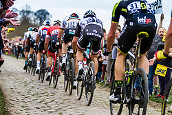 Peloton with Edward THEUNS from Belgium of Team Sunweb at the 4 star cobblestone sector 11 of Mons-en-Pévèle during the 2018 Paris-Roubaix race, France, 8 April 2018, Photo by Thomas van Bracht / PelotonPhotos.com | All photos usage must carry mandatory copyright credit (Peloton Photos | Thomas van Bracht)