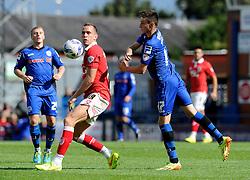 Bristol City's Aaron Wilbraham and Rochdale's Scott Tanser challenge for the ball - Photo mandatory by-line: Dougie Allward/JMP - Mobile: 07966 386802 23/08/2014 - SPORT - FOOTBALL - Manchester - Spotland Stadium - Rochdale AFC v Bristol City - Sky Bet League One