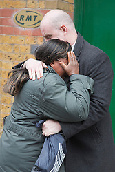 © Licensed to London News Pictures. 11 March 2014. London, England. Pictured: A distraught London Underground Worker and RMT member is comforted by Steve Hedley, the Assistant General Secretary,  outside the RMT headquarters in Chalton Street, London. Photo credit: Bettina Strenske/LNP