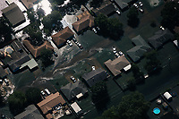 &quot;America in the Middle&quot; is a collection of images showing communities and individuals personally affected by policies but often-overlooked by politicians. |||<br /> <br /> Polluted floodwater surrounds homes in Beaumont, Texas.<br /> <br /> Chicago Freelance Photographer | Alyssa Schukar | Photojournalist