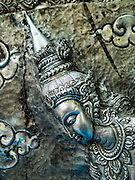 "03 APRIL 2016 - CHIANG MAI, THAILAND: Silver relief of a Thai dancer at Wat Sri Suphan. Wat Sri Suphan is also known as the ""Silver Temple"" because of its silver ubosot, or ordination hall. The temple is more than 500 years old but the silver ordination hall was recently remodeled. The ordination hall is covered in silver and the interior is completely done in silver and gold. It's traditionally served as the main temple for the silversmiths of Chiang Mai, whose community is around the temple.     PHOTO BY JACK KURTZ"
