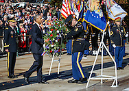 President Barack Obama places a wreath of flowers at the Tomb of the Unknown Soldier at Arlington National Cemetery during Veterans Day observance on Nov. 11, 2015. Maj. Gen. Bradley Becker, Commander of Joint Force Headquarters National Capitol Region, is at left.
