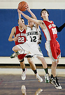 Cornwall's Zach Bouton (12) grabs the ball away from Red Hook's Joe Stortini (00) during the Section 9 Class A championship game at SUNY New Paltz on Friday, March 4, 2011.
