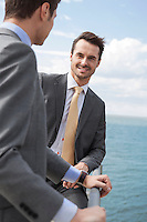Portrait of businessman with coworker on terrace