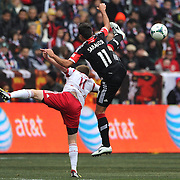 Legs eleven? Opposing numbers Dax McCarty, New York Red Bulls, (left) and Marcelo Saragosa, D.C. United,  in action during the New York Red Bulls V D.C. United, Major League Soccer regular season match at Red Bull Arena, Harrison, New Jersey. USA. 16th March 2013. Photo Tim Clayton