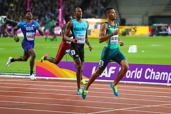London, August 08 2017 . Wayde van Niekerk, South Africa, wins the men's 400m final with Steven Gardiner, Bahamas, second and Abdalelah Haroun, Qatar, in third on day five of the IAAF London 2017 world Championships at the London Stadium. © Paul Davey.
