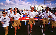 HAVANA, CUBA: Cuban teenagers march in front of the American Interests Section, the US unofficial embassy in Havana, Cuba, February 22, 2000. Thousands of Cubans marched in front of the interest section to protest the US unwillingness to return Elian Gonzalez to his father in Cuba.    Photo by Jack Kurtz  CROWDS     HUMAN RIGHTS    YOUTH    EDUCATION      CHILDREN     PATRIOTISM