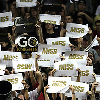 Fans hold signs to miss during a Conference USA NCAA basketball game between the Marshall Thundering Herd and the Central Florida Knights at the UCF Arena on January 5, 2011 in Orlando, Florida. Central Florida won the game 65-58 and extended their record to 14-0.  (AP Photo/Alex Menendez)