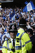 Police in front of Millwall fans. Before the FA Cup Final 2004, Manchester United v Millwall, May 22 2004.