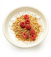 Cereal in a white bowl with milk