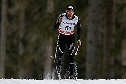 13.12.2014, Davos, SUI, FIS Langlauf Weltcup, Davos, 15 km, Herren, im Bild Jason Rueesch (SUI) // during Cross Country, 15km, men at FIS Nordic world cup in Davos, Switzerland on 2014/12/13. EXPA Pictures &copy; 2014, PhotoCredit: EXPA/ Freshfocus/ Christian Pfander<br /> <br /> *****ATTENTION - for AUT, SLO, CRO, SRB, BIH, MAZ only*****