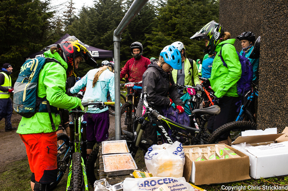 Glentress, Peebles, Scotland, UK. 31st May 2015. Riders take shelter and stock up on energy at The Enduro World Series Round 3 taking place on the iconic 7Stanes trails during Tweedlove Festival. Day two's weather was wintry with strong winds and rain and low temperatures.