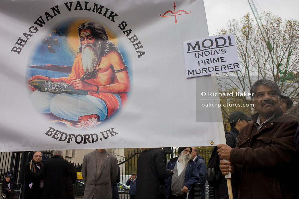 Protesters in Whitehall demonstate against the three-day visit to the UK by Indian Prime Minister Narendra Modi. Sikhs rest during the event beneath the statue of Field Marshal, the Viscount Alan Brooke outside the Ministry of Defence building.