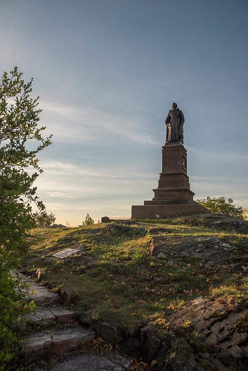 Statue of Father Jacques Marquette overlooking Lake Superior and downtown Marquette, Michigan.