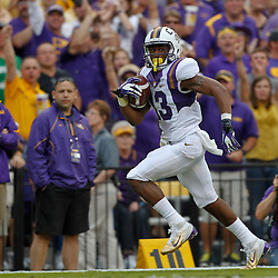 October 22, 2011; Baton Rouge, LA, USA; LSU Tigers cornerback Ron Brooks (13) returns an interception for a touchdown against the Auburn Tigers during the second half at Tiger Stadium. LSU defeated Auburn 45-10. Mandatory Credit: Derick E. Hingle-US PRESSWIRE / © Derick E. Hingle 2011