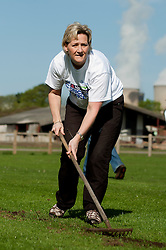NatWest staff member Heidi Hughes rakes out dead grass at Drax Cricket club near Selby ready for reseeding on Sunday Morning (10April 2011)..10 April 2011.Images © Paul David Drabble