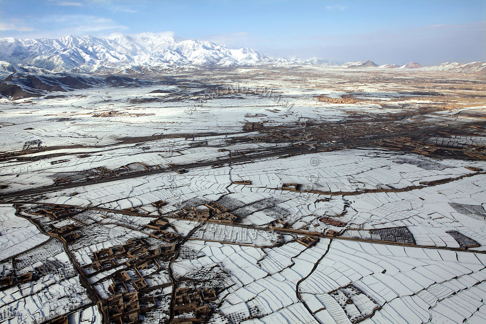 Villages are photographed from the air while travelling over the Hidu Kush range between Kabul and Bamyan, central Afghanistan, an area mostly populated by Hazaras. A historically persecuted minority (15%) due to more lenient Islamic faith and characteristic 'Eastern' lineaments, Hazaras constitute the 70% of Bamyan's population.