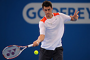 Brisbane, Australia, December 30: Bernard Tomic of Australia plays a forehand shot during a training session at Pat Rafter Arena ahead of the 2012 Brisbane International Tennis Tournament in Brisbane, Australia on Friday December 30th, 2011. (Photo: Matt Roberts/Photo News)