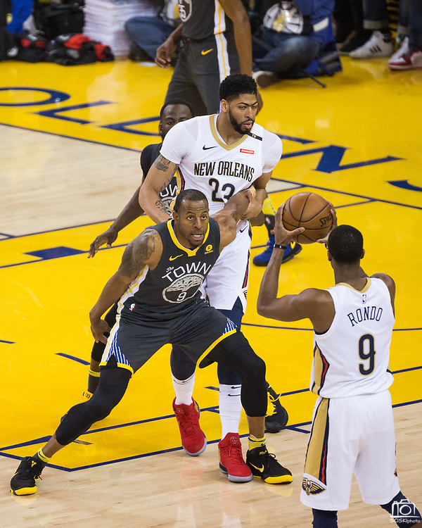 Golden State Warriors forward Andre Iguodala (9) double teams New Orleans Pelicans forward Anthony Davis (23) at Oracle Arena during Game 2 of the Western Semifinals in Oakland, California, on May 1, 2018. (Stan Olszewski/Special to S.F. Examiner)