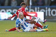 Huddersfield Town midfielder, on loan from Manchester City, Aaron Mooy (10) tackles Birmingham City  midfielder David Davis (26)  during the EFL Sky Bet Championship match between Huddersfield Town and Birmingham City at the John Smiths Stadium, Huddersfield, England on 5 November 2016. Photo by Simon Davies.