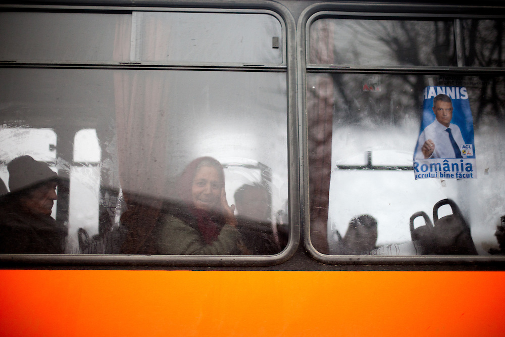 Portrait of Niculina - a Roma woman riding the bus for getting back home from work from Marginenii de Jos to another village.